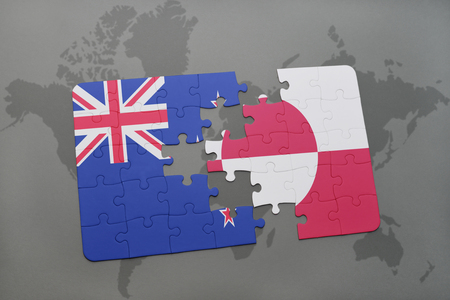 separatism: puzzle with the national flag of new zealand and greenland on a world map background. 3D illustration Stock Photo