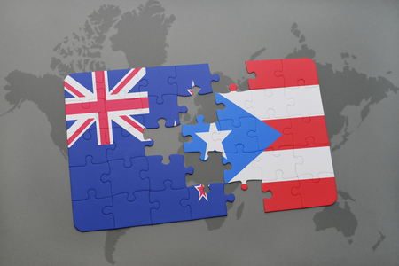 bandera de puerto rico: puzzle with the national flag of new zealand and puerto rico on a world map background. 3D illustration Foto de archivo