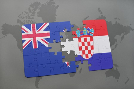 separatism: puzzle with the national flag of new zealand and croatia on a world map background. 3D illustration Stock Photo