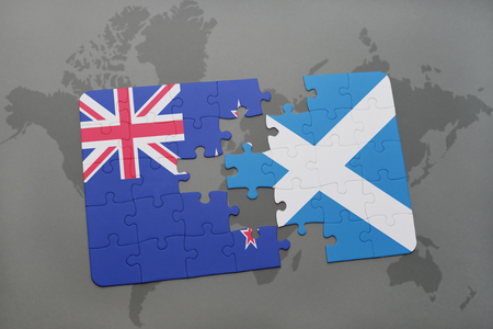 separatism: puzzle with the national flag of new zealand and scotland on a world map background. 3D illustration Stock Photo