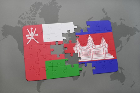 separatism: puzzle with the national flag of oman and cambodia on a world map background. 3D illustration