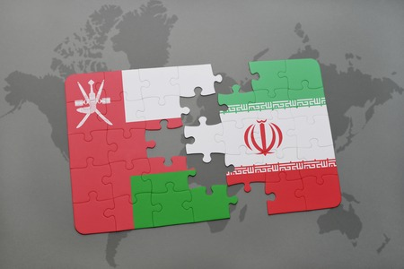 oman background: puzzle with the national flag of oman and iran on a world map background. 3D illustration