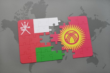 separatism: puzzle with the national flag of oman and kyrgyzstan on a world map background. 3D illustration