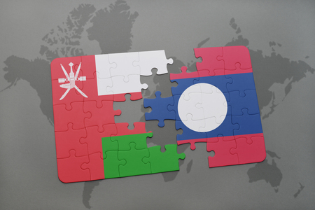 middle east crisis: puzzle with the national flag of oman and laos on a world map background. 3D illustration