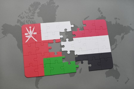 middle east crisis: puzzle with the national flag of oman and yemen on a world map background. 3D illustration