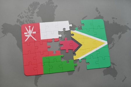 separatism: puzzle with the national flag of oman and guyana on a world map background. 3D illustration