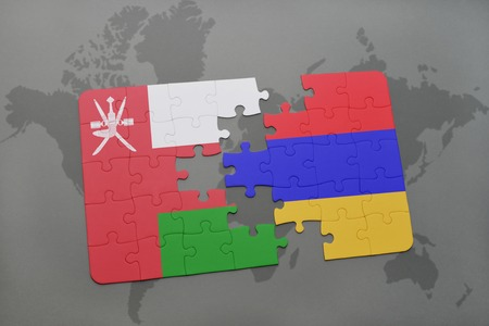 yerevan: puzzle with the national flag of oman and armenia on a world map background. 3D illustration