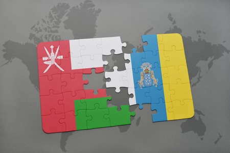 canary: puzzle with the national flag of oman and canary islands on a world map background. 3D illustration