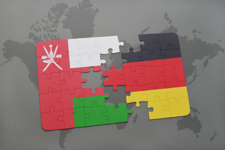 separatism: puzzle with the national flag of oman and germany on a world map background. 3D illustration Stock Photo