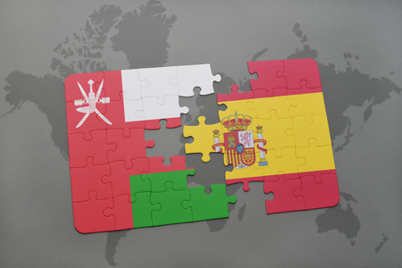 separatism: puzzle with the national flag of oman and spain on a world map background. 3D illustration