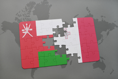 maltese map: puzzle with the national flag of oman and malta on a world map background. 3D illustration Stock Photo