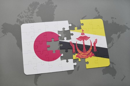 map of brunei: puzzle with the national flag of japan and brunei on a world map background. 3D illustration