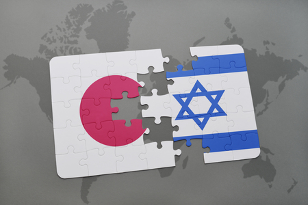 asian business: puzzle with the national flag of japan and israel on a world map background. 3D illustration Stock Photo