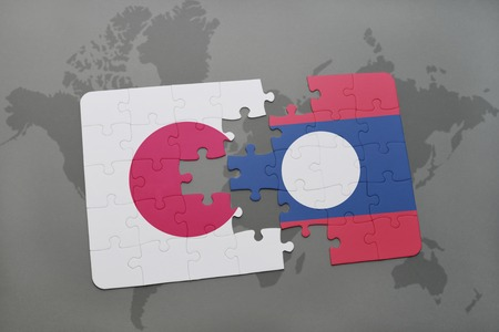 puzzle with the national flag of japan and laos on a world map background. 3D illustration