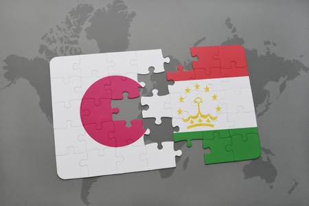 economy of tajikistan: puzzle with the national flag of japan and tajikistan on a world map background. 3D illustration Stock Photo