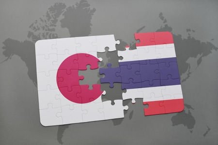 middle east crisis: puzzle with the national flag of japan and thailand on a world map background. 3D illustration
