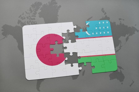 middle east crisis: puzzle with the national flag of japan and uzbekistan on a world map background. 3D illustration