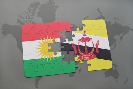map of brunei: puzzle with the national flag of kurdistan and brunei on a world map background. 3D illustration Stock Photo