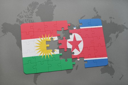 middle east crisis: puzzle with the national flag of kurdistan and north korea on a world map background. 3D illustration