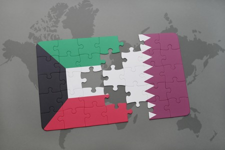 middle east crisis: puzzle with the national flag of kuwait and qatar on a world map background. 3D illustration Stock Photo