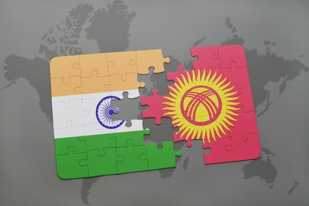 middle east crisis: puzzle with the national flag of india and kyrgyzstan on a world map background. 3D illustration Stock Photo