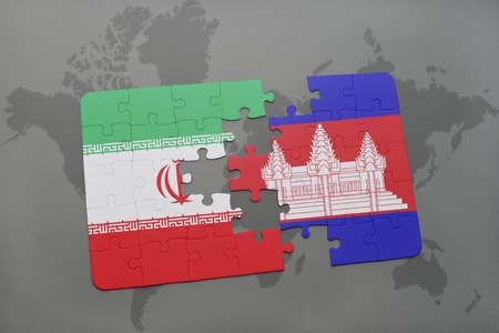 cambodian: puzzle with the national flag of iran and cambodia on a world map background. 3D illustration Stock Photo