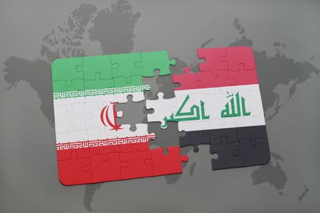 iraq conflict: puzzle with the national flag of iran and iraq on a world map background. 3D illustration