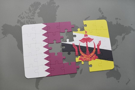 map of brunei: puzzle with the national flag of qatar and brunei on a world map background. 3D illustration