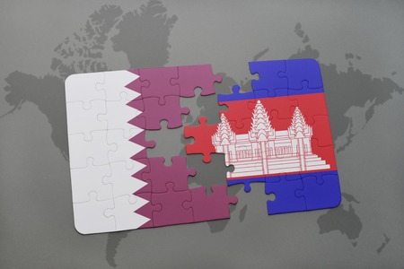 puzzle with the national flag of qatar and cambodia on a world map background. 3D illustration