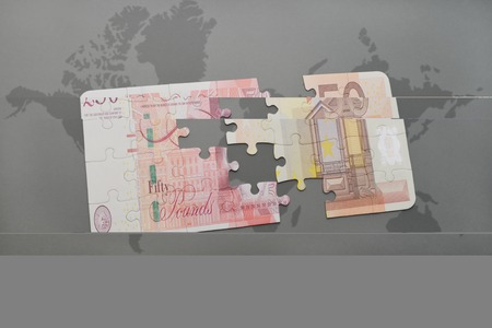 gb pound: puzzle with the national flag of and euro banknote on a world map background. 3D illustration