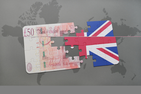 british pound: puzzle with the national flag of great britain and british pound on a world map background. 3D illustration