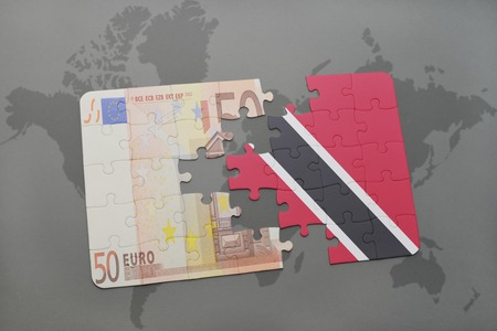 national flag trinidad and tobago: puzzle with the national flag of trinidad and tobago and euro banknote on a world map background. 3D illustration Stock Photo