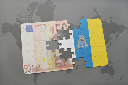 canary: puzzle with the national flag of canary islands and euro banknote on a world map background. 3D illustration