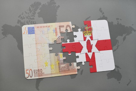 northern ireland: puzzle with the national flag of northern ireland and euro banknote on a world map background. 3D illustration Stock Photo