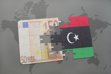 libyan: puzzle with the national flag of libya and euro banknote on a world map background. 3D illustration