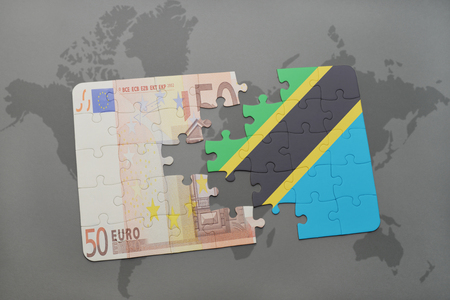 european integration: puzzle with the national flag of tanzania and euro banknote on a world map background. 3D illustration