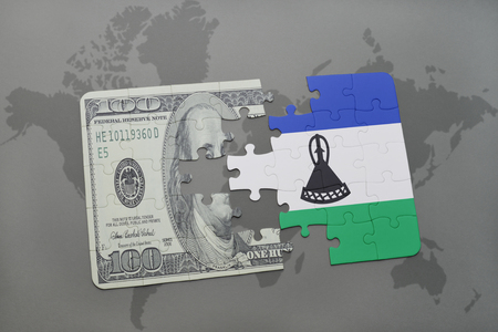 lesotho: puzzle with the national flag of lesotho and dollar banknote on a world map background. 3D illustration