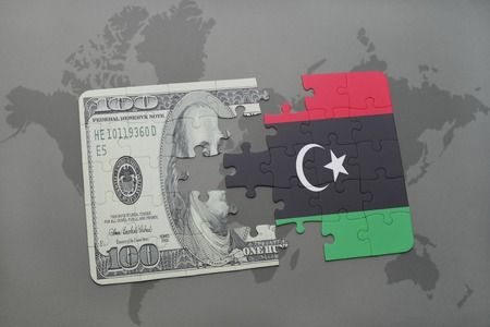 libyan: puzzle with the national flag of libya and dollar banknote on a world map background. 3D illustration