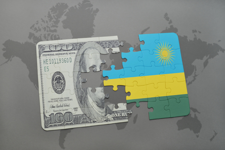 kigali: puzzle with the national flag of rwanda and dollar banknote on a world map background. 3D illustration