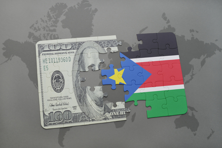 south sudan: puzzle with the national flag of south sudan and dollar banknote on a world map background. 3D illustration