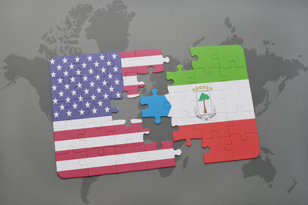 equatorial guinea: puzzle with the national flag of united states of america and equatorial guinea on a world map background. 3D illustration