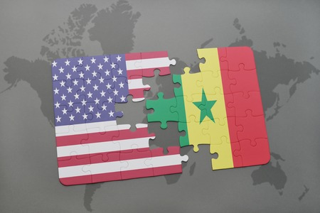 dakar: puzzle with the national flag of united states of america and senegal on a world map background. 3D illustration