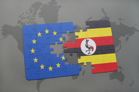 kampala: puzzle with the national flag of european union and uganda on a world map background. 3D illustration