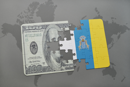 canary: puzzle with the national flag of canary islands and dollar banknote on a world map background. 3D illustration Stock Photo