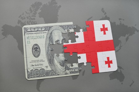 european integration: puzzle with the national flag of georgia and dollar banknote on a world map background. 3D illustration