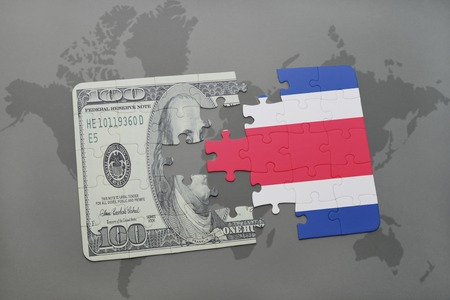 costa rican flag: puzzle with the national flag of costa rica and dollar banknote on a world map background. 3D illustration Stock Photo