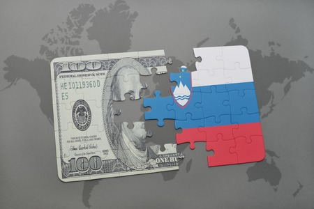 slovenian: puzzle with the national flag of slovenia and dollar banknote on a world map background. 3D illustration