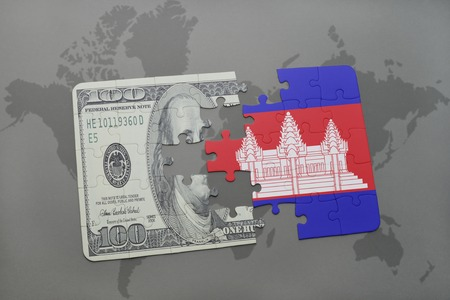 cambodian flag: puzzle with the national flag of cambodia and dollar banknote on a world map background. 3D illustration Stock Photo