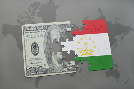 tajikistan: puzzle with the national flag of tajikistan and dollar banknote on a world map background. 3D illustration Stock Photo