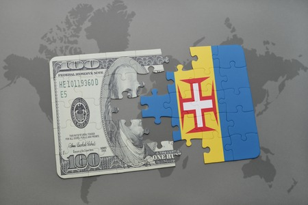 madeira: puzzle with the national flag of madeira and dollar banknote on a world map background. 3D illustration